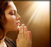 women with praying hands looking up to heaven